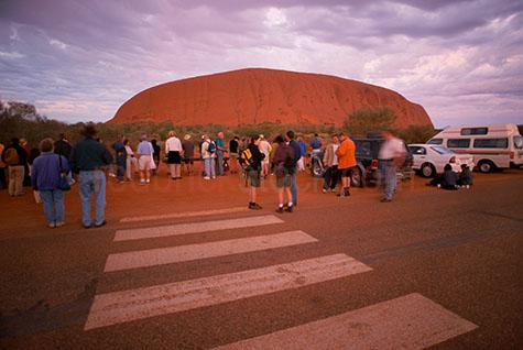 tourist;tourists;sight seeing;sightsee;sight see;travel;travelling;uluru;ayres rock;ayers rock;landmark;pedestrian crossing;northern territory;outback;tour;people;crowd;desert;central australia;rock;rocksbackpackers;travellers;sacred sight;aboriginal territory
