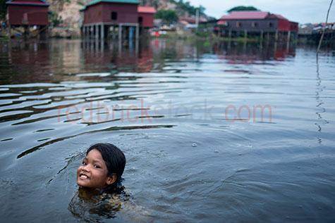 tonle sap lake;lake;lakes;freshwater lake;freshwater lakes;fresh water lake;fresh water lakes;cambodia;asia;asian;south east asia;siem reap;siem reap province;tonle sap river;river;rivers;water;wet;child;children;kid;kids;young child;young children;young kid;young kids;girl;girls;female;females;young girl;young girls;young female;young females;swim;swims;swimming;swimmer;swimmers;girl swimming;girls swimming;young girl swimming;young girls swimming;child swimming;children swimming;kid swimming;kids swimming;young kid swimming;young kids swimming;swimming in river;swimming in a river;swimming in lake;swimming in a lake;play;plays;playing;child playing;children playing;kid playing;kids playing;person;people;asian person;asian people;asian girl;asian girls;asian female;asian female;asian child;asian children;asian kid;asian kids;young asian girl;young asian girls;young asian female;young asian females;young asian child;young asian children;young asian kid;young asian kids;smile;smiles;smiling;happy;happy person;happy people;happy child;happy children;happy kid;happy kids;house;houses;home;homes;housing;house on stilts;houses on stilts;housing on stilts;stilt house;stilt houses;stilt housing;pile dwelling;pile dwellings;palafitte;palafittes;flood;floods;flooding;flood prone;flood prone area;flood prone areas;copyspace;copy space;textspace;text space;poverty;poor;poor country;poor countries;third world;third world country;third world countries;travel;travels;traveling;travelling;overseas travel;over seas travel;overseas;over seas