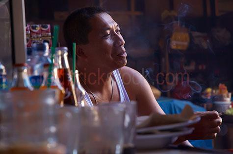 bali;balinese;indonesia;indonesian;asia;asian;men;man;guy;guys;people;person;local;locals;native;natives;smoke;smokes;smoking;smokey;cigarette;cigarettes;sit;sits;sitting;street;streets;street scene;street scenes;streetscape;streetscapes;indoor;indoors;cool;suave;relax;relaxing;relaxed;smile;smiles;smiling