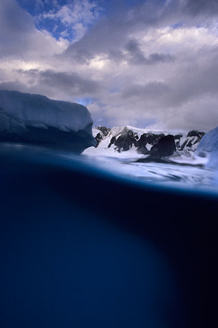 antarctica;antarctic;coast;coasts;coastal;marine;ocean;oceans;sea;seas;sea water;water;wet;snow;snowy;half and half;landscape;landscapes;over/under;seascape;seascapes;underwater;under water;underwater photography;under water photography;ice;icey;iceberg;ice berg;icebergs;ice bergs;frozen;freeze;froze;freezes;freezing;sky;skies;cloud;clouds;cloud cover;freshwater;fresh water;wildlife;wild life;deep sea;antarctic ocean;antarctic oceans;cold water;freezing water;freezing cold;cold;polar;ice cap;icecap;polar icecaps;polar icecap;global warming;climate change;rising water;environmental;environment;protection;mountain;mountains