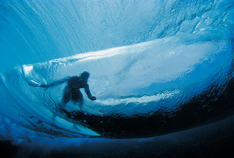 Surfer in wave;underwater;submerged;surfer;surfing wave;underwater photography;under wave;back of wave;surfing;riding a wave;surfer riding a wave;shooting underwater;in the ocean;sea;beach;beaches;crashing wave;crashing waves;dumped by wave;getting dumped by a wave;dumped by waves;getting dumped by waves;blue;blue ocean;deep blue;surfers;surfboard;surf board