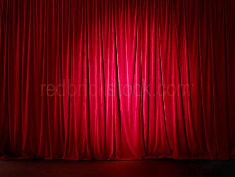 red curtain;stage;performing stage;performance;entertainment;entertain;red velvet;background;back ground;show;dinner and a show;dinner & a show;event;presentation;theatre;theatre performance;cinema;drapes;red drapes;spot light;spotlight;spotlight on red curtain;spot light on red curtain;concert;fame;famous;broadway;broad way;auditorium;party;parties;culture;production;theatre production;drama;acting;act;scene;drapery;stage performance;opening scene