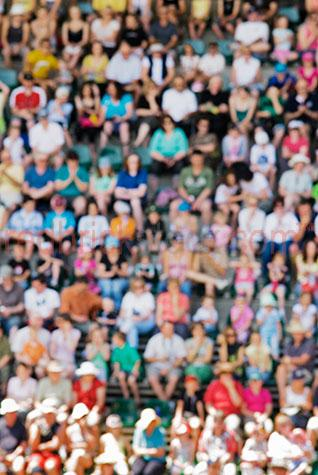 seated crowds crowd seats spectators stadium with people grand s;blur blurred background spectator mass watch watching