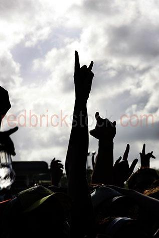 concert;revellers;concert revellers;concert goers;crowd;hands;rock concert;concerts;music;music festival;festival;festivals;band;bands;entertainment;entertainers;waving;cheering;revelling;sign;signs;signals
