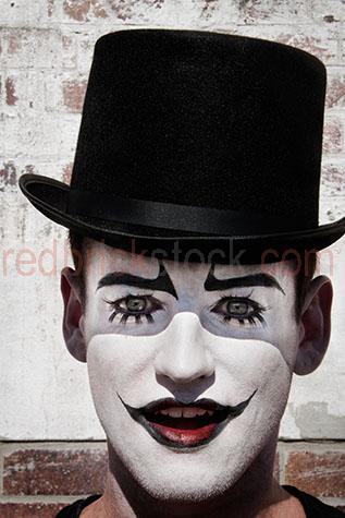 clown;clowns;clown face;clown faces;face;faces;close-up;close-ups;close-up's;close up;close ups;close up's;close-up view;close-up views;close-up view's;close up view;close up views;close up view's;clwon close-up;clown close-ups;clown close-up's;clown close up;clown close ups;clown close up's;clown face close-up;clown face close-ups;clown face close-up's;clown face close up;clown face close ups;clown face close up's;entertainer;entertainers;entertainment;entertaining;perform;performs;performance;performances;performing;amuse;amuses;amusement;amusing;circus;circus';circus's;carnival;carnivals;sidehsow alley;sideshow alleys;sideshow ally;sideshow allys;quirky;querky;facial features;lips;painted lips;eye;eyes;green eyes;eyebrows;painted eyebrows;eyelashes;fake eyelashes;face paint;face paints;painted face;face painted;white face;white faces;painted white face;painted white faces;facial hair;top hat;top hats;black top hat;black top hats;hat;hats;brick wall;brick walls;stare;stares;staring;mouth open;open mouth