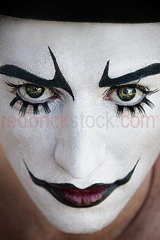 clown;clowns;clown face;clown faces;face;faces;close-up;close-ups;close-up's;close up;close ups;close up's;close-up view;close-up views;close-up view's;close up view;close up views;close up view's;clown close-up;clown close-ups;clown close-up's;clown close up;clown close ups;clown close up's;clown face close-up;clown face close-ups;clown face close-up's;clown face close up;clown face close ups;clown face close up's;entertainer;entertainers;entertainment;entertaining;perform;performs;performance;performances;performing;amuse;amuses;amusement;amusing;circus;circus';circus's;carnival;carnivals;sidehsow alley;sideshow alleys;sideshow ally;sideshow allys;quirky;querky;facial features;lips;painted lips;eye;eyes;green eyes;eyebrows;painted eyebrows;eyelashes;fake eyelashes;face paint;face paints;painted face;face painted;white face;white faces;painted white face;painted white faces;painted clown face;painted clown face close up;painted clown face close-up;facial hair;top hat;top hats;black top hat;black top hats;hat;hats;brick walls;stare;stares;staring;serious;serious expression;serious expressions