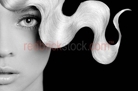 young woman;girl;face;faces;eye;eyes;hair;curly;blacl and white;b&w