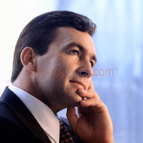 businessman;business man;office;businessman in office;business;suit;head shot;head and shoulders;portriat;business portrait;business meeting;meeting;listening;office window;window;highrise;tower;hirise;high rise;corporate;corporates