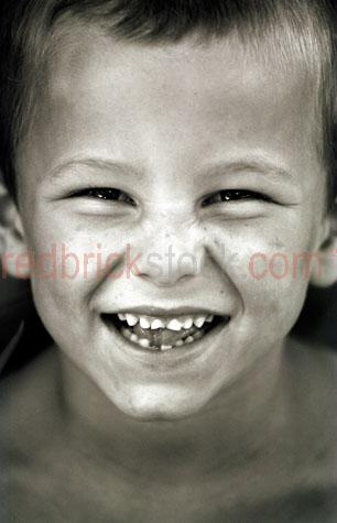 boy;little boy;smile;smiling;laugh;laughing;cheeky;cheeky smile;close up;close-up;b&w;b & w;black & white;black and white;8-10 yr old;eight to ten year old;8-10 year old;10-12 yr old;10-12;10-12 years old;ten to 12 year old;years old;australian;aussie boy;boys;kid;kids;children;child;young boy;teeth;face;faces