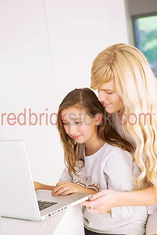 child;children;kid;kids;girl;girls;mother and daughter;mother & girl;mother;mothers;homework;study;instructing;teaching;helping;at home;home;computer;computers;laptop;laptops;using computer;apple;mac;macintosh;power book;powerbook;macbook;internet;surfing internet;searching internet;online;technology;smiling;smile;smiles;happy;sharing;indoors;interior;inside;age 10-12;10-12;10-12 years;10 to 12 years;10-12 yrs;10 to 12 yrs;age 10-15;age 10-15 yrs;10-15 years;10 to 15 years;10-15 yrs;10 to 15 yrs;copyspace;copy space;textspace;text space;australia;australian;close-up;close-ups;close up;close ups;closeup;closeups;close-up view;close-up views;closeup view;closeup views;close-up views;close-up view's;close up views;closeup views