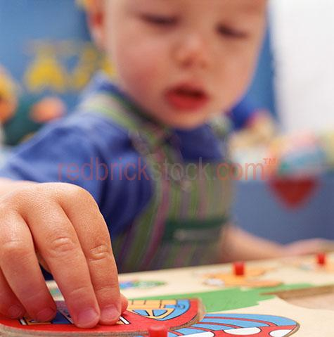 toddler boy child kid kindergarden play playing puzzle game game