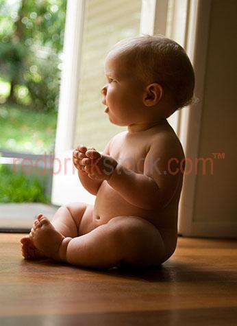 baby yard naked back looking infant young playing house home