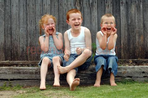 childre;kids;boys;boys and girls;having fun;back yard;backyard;yelling;calling out;laughing;playing;boy with glasses;boy wearing glasses;aussie kids;australian kids;boy and girl;young children;family;smiling