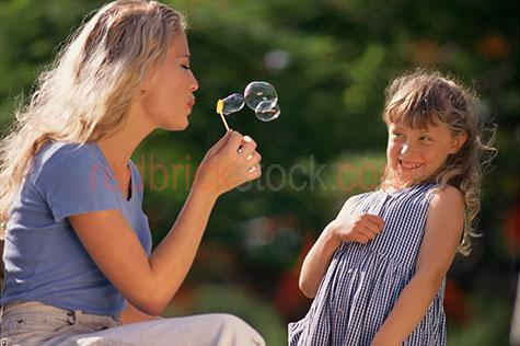 mother daughter bubbles fun leisure playing mum young girl child
