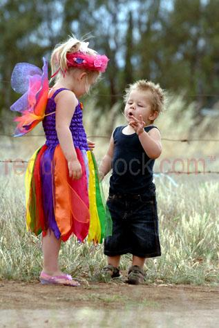 little girls in fairy costumes;outback kids;country kids;country children;outback children;little girls playing;dressing up;rural children;aussie kids;aussie children;australian children;australian kids;laughing;having fun;enjoying themselves;kids party;childrens party;young children;boy;boy and girl