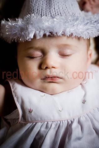 baby sleeping;baby asleep;infant;child;newborn;new born;baby sleeps;new born baby;newborn baby;eyes closed;close up;close-up;close up of baby's face;babies;small child;nuture;fragile;peaceful;peacefully asleep;kid;child;chldren;face;babies face;faces;dream;dreaming;baby dreaming;babies dreaming;parenthood;parent hood;angelic;nap;napping;baby napping;babies napping;slumber;baby wearing a hat;babies wearing hats;baby sleeping in cot;baby sleeping in crib;baby sleeping in bed;babies sleeping in cots;babies sleeping in cribs;babies sleeping in beds;baby lying on back;babies lying on backs;baby wearing a dress;babies wearing dresses;baby girl;baby girls;babies faces;baby's face;baby face;babyface;baby girl;baby girls;face;faces