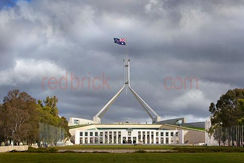 parliament house;parliament house canberra;canberra;australia;australian capital territory;australian;aus;act;parliament;politic;politics;political;government;govern;gov;australian government;building;buildings;government building;government buildings;architecture;architectural;capital city;capital cities;australian capital city;australian capital cities;capitol city;capitol cities;australian capitol city;australian capitol cities;commonwealth;parliament house australian;australian parliament house;flag;flags;australian flag;australian flags;storm;storms;stormy;stormy sky;stormy skies;stormy weather;storm cloud;storm clouds;cloud;clouds;grey cloud;grey clouds;grey sky;grey skies;gray cloud;gray clouds;gray sky;gray skies;grey storm cloud;grey storm clouds;gray storm cloud;gray storm clouds;copyspace;copy space;textspace;text space;grass;grasses;green grass;green grasses;tree;trees;tourist attraction;tourist attractions;canberra tourist attraction;canberra tourist attractions;australian tourist attraction;australian tourist attractions;tourist;tourists