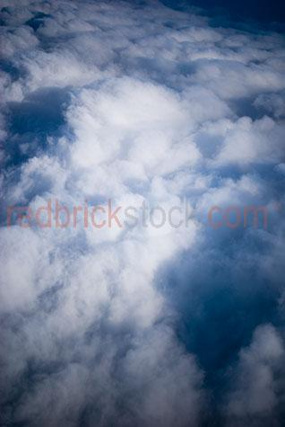 above the clouds;flying above clouds;cloud;clouds;white clouds;white cloud;fluffy white cloud;fluffy white clouds;cumulus;cumulonimbus