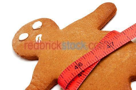 bakery;bakeries;biscuit;biscuits;ginger biscuit;ginger biscuits;gingerbread man;gingerbread men;gingerbread biscuit;baked;bake;tapemeasure;tapemeasures;tape measure;tape measures;measuring tape;measuring tapes;red tape measure;facial expression;facial expressions;worried look;unhappy;unhappy look;distressed;anxious;overweight;heavy;unhealthy weight;health issue;health issues;weight issue;weight issues;diet;diets;unhealthy eating;party snack;snack;snacks;white background;white backgrounds;on white;cut out