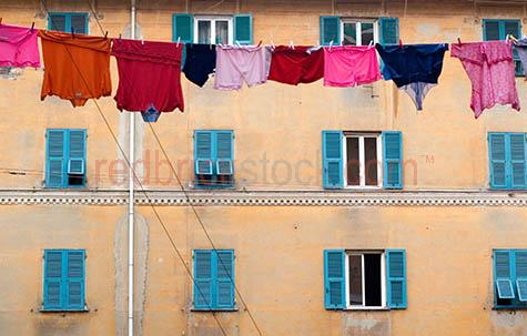 clothes hanging on line;clothes hanging on washing line;t-shirts;t-shirt;tshirt;tshirts;underwear;clothes;clothing;building;buildings;window;windows;pegs;peg;conceptual;washing on line;clean clothes;dry;drying;hanging out to dry;hang out to dry;laundry;laundry on the line
