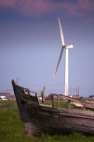 environment;environmental;environmental issue;environmental issues;conservation;sustainability;sustainable;green;green energy;energy;renewable;renewable resources;resource;resources;resource depletion;natural energy;climate change;fossil fuel;alternate;alternative;alternative energy;wind;wind turbine;wind powered;wind-powered;boat;wreck;wrecked boat;abandoned;abandoned boat;junk;thrown away;discarded;dumped;dump;waste;debris;old;new;old and new;old & new;new and old;new & old;new versus old;new vs old;change;progress;editorial;contrast;juxtaposition;concept;concepts;textspace;text space;copyspace;copy space