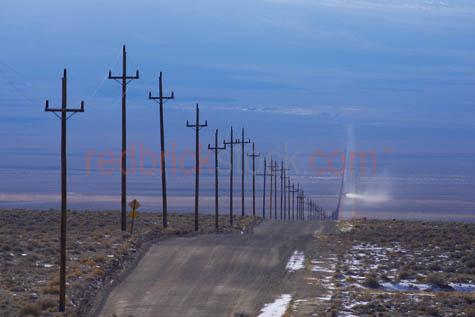 power poles;electricity poles;electricity;power;power lines;electricity lines;power supply;long road;straight road;usa;united states;travel;road trip;travelling;road;roads;snow