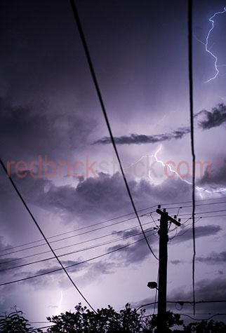 electrical storm;lightning;thunder;severe weather;stormy weather;rain clouds;dangerous weather;cloud;clouds;electricity;electric;lightning bolt;lightning bolts;storm;storms; storm sky;stormy skies;storm conditions;stormy conditions;thundery sky;thundery skies;dark sky;dark skies;power pole;power poles;powerpole;powerpoles;electricity grid;energy grid;electricity grids;energy grids;energy;energies;line;lines;power line;power lines;powerlines;powerline;technology;cable;cables;voltage;power supply;power supplies;electricity supply;electricity supplies;network;utility;utilities;telephone wire;telephone wires;communication;communications;purple;purples;colour purple;color purple;dark;moody;