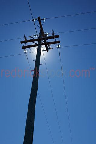 power pole powerpole electricty grid energy line lines blue sky