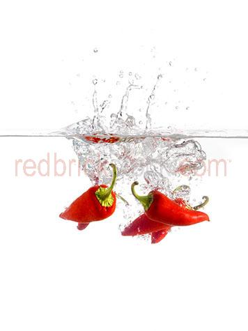 chili;chilies;chilis;chilli;chillis;chilli's;spices;spice;spicy;food;hot;fresh food;ingredient;ingredients;red chili;red chillies;red chilies;red chilli;flavour;flavor;flavouring;flavoring;flavors;flavours;pepper;peppers;red pepper;red peppers;raw;uncooked;splashing into water;drop;dropping;dropped;splash;splashes;bubble;bubbles;fresh;raw;uncooked