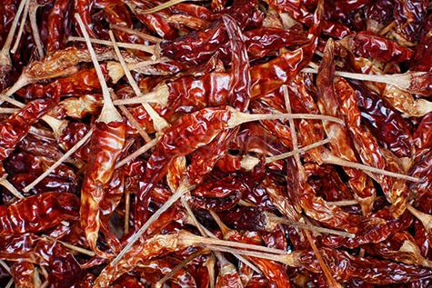 chili;chilies;chilis;chilli;chillis;chilli's;spices;spice;spicy;food;hot;fresh food;ingredient;ingredients;red chili;red chillies;red chilies;red chilli;flavour;flavor;flavouring;flavoring;flavors;flavours;pepper;peppers;red pepper;red peppers;red;reds;colour red;color red;dried chili;dried chilies;dried chilli;dried chillies;whole;selective focus