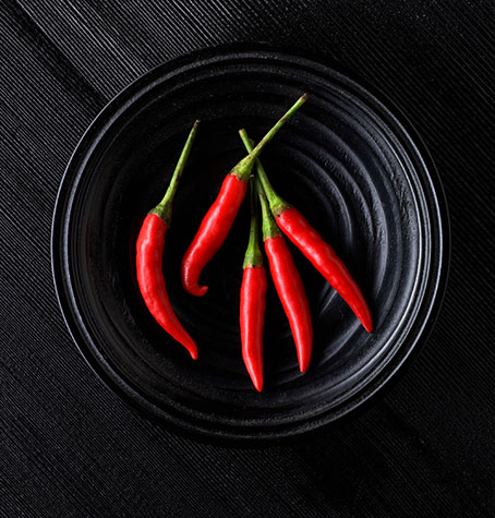 chili;chilies;chilis;chilli;chillis;chilli's;spices;spice;spicy;food;hot;fresh food;ingredient;ingredients;red chili;red chillies;red chilies;red chilli;flavour;flavor;flavouring;flavoring;flavors;flavours;pepper;peppers;red pepper;red peppers;green pepper;green peppers;raw;uncooked;bowl;bowls;chillies in bowl;chilis in bowl;black background;black backgrounds