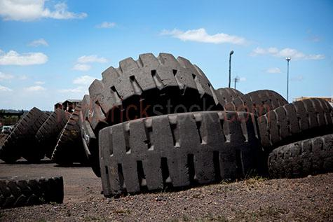 mining truck tyres;mining truck tyre;tyre;tyres;heavy industry;industry;industries;industrial;mine;mining;rubber;recycle;recycling;transport;pile of tyres;stack of tyres;tyres piled;piles of tyres;tyre recycling yard;tyre depot