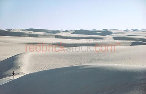 isolated isolation person alone desert sand dune dunes