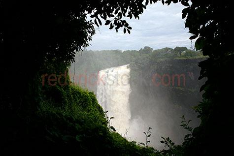 africa;victoria falls;fall;waterfall;waterfalls;water fall;water falls;zimbabwe;zambia;water;waters;southern africa;zambezi river;rivers;mosi-oa-tunya;southern africa;seven natural wonders of the world;travel;travels;travelling;traveling;mist;forest;forests;dense shrubland;shrub land;shrubs;shrub lands;shrublands
