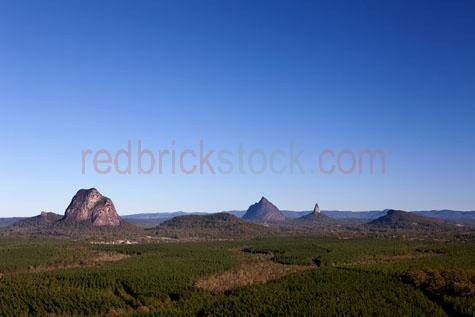 glass house mountains;glasshouse mountains;sunshine coast;queensland;landscape;landscapes;mountain;mountains;mt beerwah;mount beerwah;mt coonowrin;mount coonowrin;rock face;cliff;cliffs;cliff face;cliff faces;bush;bushland;scrub;scrubland;early morning;early morning light;blue sky;blue skies;sunshine coast;south east queensland;se queenslad;qld;glass house mountains;glass house mountain;nature;landscape;outdoor;outdoors;national park;national parks;volcanic;volcanic plug;volcanic plugs;range;ranges;mountain range;mountain ranges;mountain peak;mountain peaks;peak;peaks;caboolture;distant view;clear sky;clear skies;clear day;dytime;clear blue sky;copyspace;copy space;textspace;text space