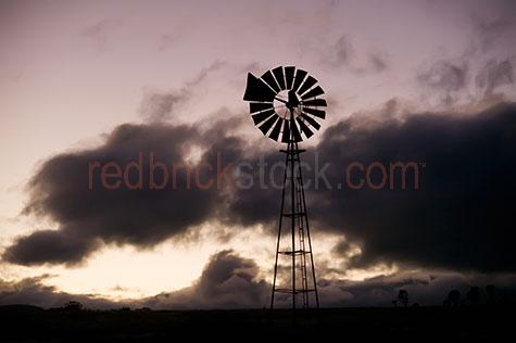 windmill;windmills;wind mill;wind mills;farm;farms;farmland;farmlands;farm land;farm lands;turbine;turbines;blade;blades;rotating;rotates;rotate;sunrise;sunrises;sun rise;sun rises;sunset;sunsets;sun set;sun sets;dawn;dawns;dusk;dusks;land;rural;country;outback;australia;australian;early morning;cloud;clouds;dark cloud;dark clouds;silhouette;silhouettes;silhouetted;copy space;copy spaces;text space;text spaces