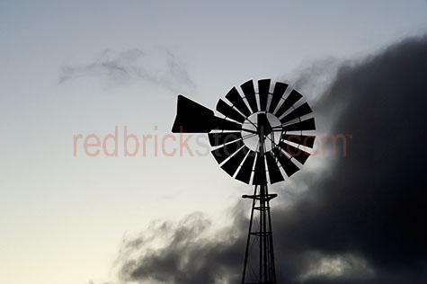windmill;windmills;wind mill;wind mills;farm;farms;farmland;farmlands;farm land;farm lands;turbine;turbines;blade;blades;rotating;rotates;rotate;sunrise;sunrises;sun rise;sun rises;sunset;sunsets;sun set;sun sets;dawn;dawns;dusk;dusks;land;rural;country;outback;australia;australian;early morning;cloud;clouds;dark cloud;dark clouds;silhouette;silhouettes;silhouetted;copy space;copy spaces;text space;text spaces;close up;close ups;close-up;close-ups