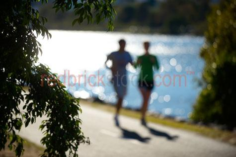 couple jogging;couple jogging beside brisbane river;couple jogging along brisbane river;jogging beside brisbane river;jogging along brisbane river;river walj;coronation dr;coronation drive;toowong;milton;exercise;exercising;running;running beside brisbane river;running along brisbane river;fit;fitness;training;path;pathway;pathways;keeping fit;personal trainer;personal training