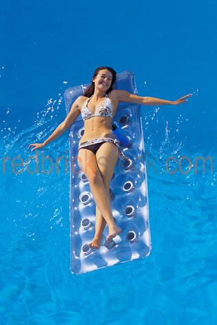 girl;woman;in;swimming;pool;blue;water;floating;air;mattress;bed;lilo;lylo;teenage;young;swimsuit;swim;