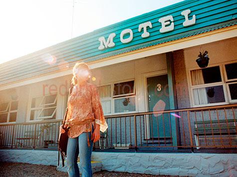 girl at motel;woman at motel;young woman at motel;accommodation;lens flare;roadside accommodation;road side accommodation;backpacker;traveler;drifter;gypsie;gypsy;motels;motel accommodation;girl leaving motel;woman leaving motel;young woman leaving motel;20-25 years;20 to 25 years;20-25 yrs;20 to 25 yrs;young adult;mid 20s;mid 20Õs mid twenties;25-30 years;25 to 30 years;25-30 yrs;25 to 30 yrs