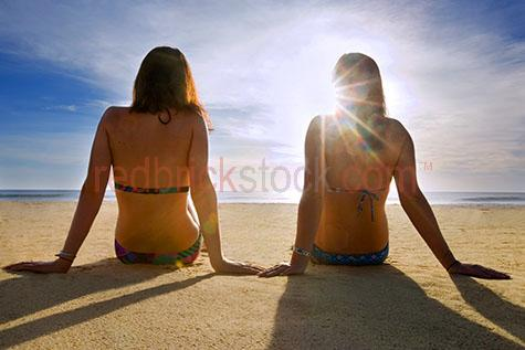 friends;friend;best friends;best friends on the beach;hanging out on the beach;friends hanging out on the beach;best friends hanging out on the beach;two girls;girl;girls;sisters;sister;sisters on the beach;beaches;teenagers on the beach;teenager on the beach;having fun at the beach;friendship;summer;friends;friend;girls on the beach;teens on the beach;teen on the beach;happy;happiness;youth;fun;togetherness;together;happy youth;playing on the beach;relaxing on the beach;friends relaxing on the beach;piggy back;piggy backing a friend;carrying a friend;bikini;bikinis;girls in bikinis;girls at the beach;summertime;summer time;adolescents;adolescent;15-20 years;15 to 20 years;15-20 yrs;15 to 20 yrs;adolescent;teen;young adult;20-25 years;20 to 25 years;20-25 yrs;20 to 25 yrs;young adult;mid 20s;mid 20Õs mid twenties;silhouettes;silhouetted;silhouette;two girls sitting on beach;girls sitting on beach;sunrise;sun rise;sunrise beach;sisters on the beach at sunrise;two girl sitting on becah at sunrise;looking out to sea;two girls looking out to sea;relax on the beach;girls relaxing on the beach