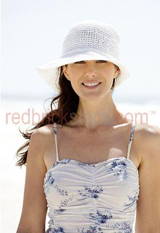 young woman on the beach;woman on beach;woman smilling;summer;beach;beaches;one girl;one woman;one young lady;one person;woman looking at camera;looking at camera;on the beach;coastal lifestyle;sunshine;outdoors;summer dress;woman in dress;brunette woman;woman wearing a hat;girl wearing a hat;wearing a hat;hats;wearing hats;smile;smiling;woman smiling;girl smiling;youth;beauty;20-25 years;20 to 25 years;20-25 yrs;20 to 25 yrs;young adult;mid 20s;mid 20Õs mid twenties;25-30 years;25 to 30 years;25-30 yrs;25 to 30 yrs