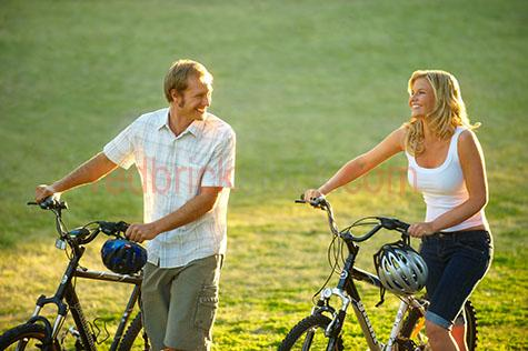 young;youth;couple;push bike;bikes;bicycles;bicycle;west end;highgate hill;brisbane;relax;exercise;relaxing;laughing;laugh;smile;smiling;two people;man;woman;guy;girl;lady