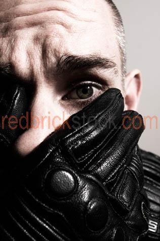 man;portrait;anguish;worry;fear;hand;leather;glove;over;mouth;