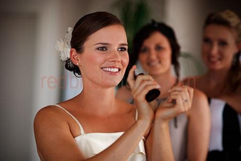 wedding;weddings;bride;brides;bride's preparation;getting ready;preparation;preparations;prep;prepare;preparing;prepares;formal;formal wear;formalwear;clothes;marriage;marriages;matrimony;well dressed;well-dressed;hand;hands;woman;women;lady;ladies;one bride;perfume;perfumes;bridesmaid;bridesmaids;bride's maid;bride's maids;brides maid;brides maids;brown eyes;brown hair;young woman;young women;selective focus;smile;smiles;smiling;grin;grins;grinning;people;person;group;groups;white dress;white dresses;event;events;occasion;occasions;bridal party;bridal parties
