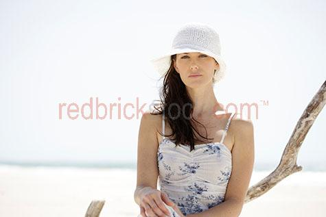girl on beach;girls on the becah;girl at the beach;girls at the beach;woman on beach;woman at the beach;women at the beach;girl wearing summer dress;woman wearing summer dress;girls wearing summer dresses;girl wearing hat;girls wearing hats;woman wearing hat;women wearing hats;looking away from camera;girl;woman;lady;young woman;young lady;one person;20-25 years;20 to 25 years;20-25 yrs;20 to 25 yrs;young adult;mid 20s;mid 20Õs mid twenties;25-30 years;25 to 30 years;25-30 yrs;25 to 30 yrs;young woman sitting on the beach;woman sitting on the beach;woman sitting;girl sitting on the beach;woman looking at camera;girl looking at camera;young woman looking at camera;lady looking at camera