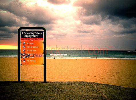 beach sign sand clouds storm cumulus moody dark