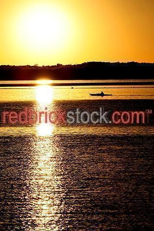 rowboat;rowboats;row boat;row boats;boat;boats;canoe;canoes;kayak;kayaks;dinghy;dinghys;fishing;marine;sunrise;sun rise;sunrises;sun rises;sun set;sunsets;sun sets;sunset;dawn;dusk;fishing boat;fishing boat;silhouette;silhouettes;silhouetted;silhouetted boat;silhouetted boats;water;ocean;oceans;sea;seas;gold coast;queensland;yellow;yellows;colour yellow;color yellow