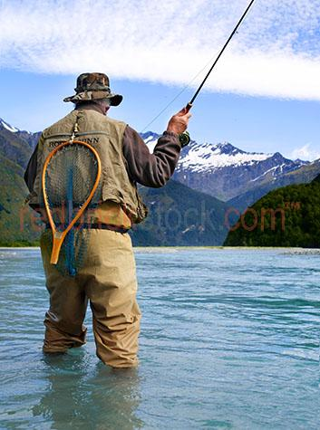 fly fishing;fish;sport;recreation;make;making;lure;tackle;hands;hand;angling;trout;lake taupa;new zealand;nz;flies;rod;lures;feathers;feather;fresh water;artificial;freshwater;man;male;person;net;nets;water;mountains;mountain