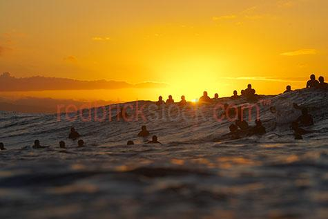 surfer;surfers;silhouette;silhouetted;silhouettes;surf;surfing;waiting for wave;sunset;sun set;ocean;water;sea;beach;ride;riding